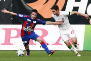 Zoran Tosic (L) of PFC CSKA Moscow battles for the ball with Magomed Ozdoev of FC Lokomotiv Moscow during the Russian Football League Championship match between PFC CSKA Moscow and FC Lokomotiv Moscow at Arena Khimki on June 22, 2011 in Khimki, Russia.