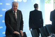 In this image shot through a pain of glass Horst Seehofer (L), Chairman of the Bavarian Social Union (CSU), arrives for a meeting of the CSU leadership at party headquarters on October 15, 2018 in Munich, Germany. The CSU faired poorly in the election, winning 37.2% of the vote, 10.5 votes fewer than in the last election. The CSU has long been Bavaria's strongest party but will now face the arduous task of forming a state government coalition.