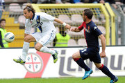 Diego Forlan (L) of Inter Milan and Alessandro Agostini of Cagliari in action during the Serie A match between Cagliari Calcio and FC Internazionale Milano at Stadio Nereo Rocco on April 7, 2012 in Trieste, Italy.