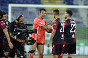 Gianluigi Buffon  of Juventus and the players of Cagliari    during the Serie A match between Cagliari Calcio and  Juventus at Sardegna Arena on July 29, 2020 in Cagliari, Italy.