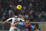 Maxi Lopez (C) of Catania competes for the ball in air with Andrea Lazzari and Edinaldo Gomes Pereira of Udinese during the Serie A match between Calcio Catania and Udinese Calcio at Stadio Angelo Massimino on November 9, 2013 in Catania, Italy.
