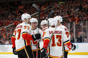 Dougie Hamilton #27, Matthew Tkachuk #19, Micheal Ferland #79, Sean Monahan #23, Johnny Gaudreau #13 and Mark Giordano #5 of the Calgary Flames celebrate Giordano's goal against the Edmonton Oilers at Rogers Place on January 25, 2018 in Edmonton, Canada.