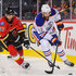 Eric Gryba Photos - Michael Frolik #67 of the Calgary Flames chases Eric Gryba #62 of the Edmonton Oilers during a pre-season NHL game at Scotiabank Saddledome on September 21, 2015 in Calgary, Alberta, Canada. - Calgary Flames v Edmonton Oilers