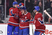 Brendan Gallagher #11 of the Montreal Canadiens celebrates his second-period goal with teammates Jeff Petry #26 and Tomas Tatar #90 against the Calgary Flames during the NHL game at the Bell Centre on October 23, 2018 in Montreal, Quebec, Canada.