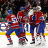 Mathieu Darche Roman Hamrlik Photos - Members of the Montreal Canadiens celebrate with goalie Carey Price #31 after defeating the Calgary Flames in overtime during their NHL game at the Bell Centre on January 17, 2011 in Montreal, Quebec, Canada.  The Canadiens defeated the Flames 5-4 in overtime. - Calgary Flames v Montreal Canadiens