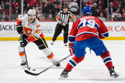 Michael Frolik #67 of the Calgary Flames skates the puck against Andrei Markov #79 of the Montreal Canadiens during the NHL game at the Bell Centre on March 20, 2016 in Montreal, Quebec, Canada.