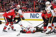 Mark Giordano #5 of the Calgary Flames blocks a shot as the puck is loose and teammate Matthew Tkachuk #19 and Mikael Backlund #11 defend against Cody Ceci #5 and Jean-Gabriel Pageau #44 of the Ottawa Senators in the second periodat Canadian Tire Centre on March 9, 2018 in Ottawa, Ontario, Canada.