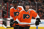 Claude Giroux #28 of the Philadelphia Flyers and teammate Wayne Simmonds #17 look on in the second period against the Calgary Flames at Wells Fargo Center on March 3, 2015 in Philadelphia, Pennsylvania.