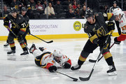 Jonathan Marchessault #81 of the Vegas Golden Knights skates with the puck as Mark Giordano #5 of the Calgary Flames dives to defend in the second period of their game at T-Mobile Arena on February 21, 2018 in Las Vegas, Nevada. The Golden Knights won 7-3.