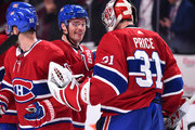 Max Domi #13 of the Montreal Canadiens congratulates goaltender Carey Price #31 of the Montreal Canadiens for his 289th career win tying Patrick Roy's second place franchise record against the Calgary Flames during the NHL game at the Bell Centre on October 23, 2018 in Montreal, Quebec, Canada.  The Montreal Canadiens defeated the Calgary Flames 3-2.