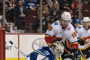 James Neal #18 of the Calgary Flames looks for the loose puck after goalie Jacob Markstrom #25 of the Vancouver Canucks makes a save in NHL action on October, 3, 2018 at Rogers Arena in Vancouver, British Columbia, Canada.
