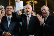 Gov. Jerry Brown (C) holds up a legislation which he signed authorizing initial construction of California's $68 billion high-speed rail line with Los Angeles Mayor Antonio Villaraigosa (L) and state and city officials looking at Union Station on July 18, 2012 in Los Angeles, California. The bill authorizes $10 billion in state bonds to start construction of a high-speed rail line between Los Angeles and San Francisco.