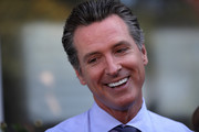 Democratic California gubernatorial candidate Lt. Gov. Gavin Newsom (R) talks with reporters after voting at the Masonic Temple Fairfax on June 5, 2018 in Larkspur, California.  California Lt. Gov. Gavin Newson cast his ballot as California voters are heading to the polls to vote in the primary election. Newsom is expected to claim the top spot in the California gubernatorial primary election ahead of republican candidate John Cox and former Los Angeles mayor Antonio Villaraigosa, a democrat.