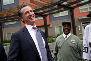 California Lt. Gov. and California gubernatorial candidate Gavin Newsom (L) laughs with a resident as he visits the Alice Griffith Apartments on August 22, 2018 in San Francisco, California. Lt. Gov. Gavin Newsom and San Francisco mayor London Breed toured a low-income housing complex. Newsom leads Republican gubernatorial candidate John Cox by an average of 23 percentage points in recent polls.