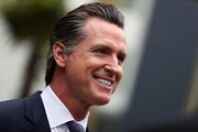 California Lt. Gov. and California gubernatorial candidate Gavin Newsom looks on as he visits the Alice Griffith Apartments on August 22, 2018 in San Francisco, California. Lt. Gov. Gavin Newsom and San Francisco mayor London Breed toured a low-income housing complex. Newsom leads Republican gubernatorial candidate John Cox by an average of 23 percentage points in recent polls.