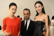 Model Du Juan (L), Women's Creative Director of Calvin Klein Francisco Costa (C) and Supermodel Qin Shu Pei pose for pictures during the Calvin Klein special dinner at the Long March Space in 798 Art District on November 12, 2012 in Beijing, China.