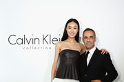 Supermodel Qin Shu Pei (L) and Francisco Costa, Women¡¯s Creative Director pose for picture during a special dinner to celebrate Calvin Klein Collection at the Long March Space in 798 Art District on November 12, 2012 in Beijing, China.