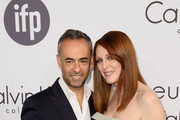 Designer Francisco Costa (L) and Actress Julianne Moore attend the Calvin Klein party during the 67th Annual Cannes Film Festival on May 15, 2014 in Cannes, France.