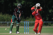 Zubin Surkari of Canada in action as Maurice Ouma of Kenya watches during the ICC World Cricket League Division One match between Canada and Kenya at the Excelsior Cricket Club on July 9, 2010 in Schiedam, Netherlands.