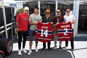 Fernando Alonso of Spain and McLaren F1 and Stoffel Vandoorne of Belgium and McLaren F1 swap shirts with hockey players, including Hampus Lindholm of the Anaheim Ducks, Max Pacioretty of the Montreal Canadiens and Nicolas Deslauriers of the Montreal Canadiens.before the Canadian Formula One Grand Prix at Circuit Gilles Villeneuve on June 10, 2018 in Montreal, Canada.