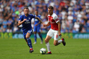 Joe Ralls of Cardiff City and Aaron Ramsey of Arsenal during the Premier League match between Cardiff City and Arsenal FC at Cardiff City Stadium on September 2, 2018 in Cardiff, United Kingdom.