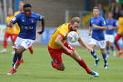 Kevin van Veen of Northampton Town contests the ball with Kelvin Etuhu of Carlisle United during the Sky Bet League Two match between Carlisle United and Northampton Town at Brunton Park on August 11, 2018 in Carlisle, United Kingdom.