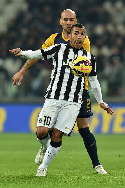 Juventus FC v Hellas Verona FC  [player,sports,soccer player,sports equipment,football player,soccer,team sport,ball game,tournament,football,r,carlos tevez,guillermo rodriguez,juventus arena,italy,turin,juventus fc,hellas verona fc,serie a,match]