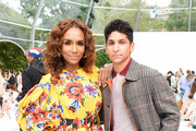 Janet Mock and Adrian Vera attend the front row of Carolina Herrera fashion show during New York Fashion Weekon September 09, 2019 in New York City.