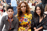 Angel Bismark Curiel, Janet Mock and Vanessa Hudgens attend the front row of Carolina Herrera fashion show during New York Fashion Weekon September 09, 2019 in New York City.