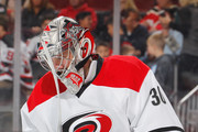 Goalie Cam Ward #30 of the Carolina Hurricanes looks down during a break in action in an NHL hockey game against the New Jersey Devils at the Prudential Center on November 8, 2016 in Newark, New Jersey. Devils won 3-2 in a shootout.