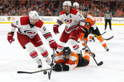 Kris Versteeg #32 of the Carolina Hurricanes and Pierre-Edouard Bellemare #78 of the Philadelphia Flyers battle for the puck in the second period at Wells Fargo Center on December 15, 2015 in Philadelphia, Pennsylvania.