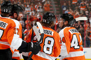 Kimmo Timonen #44 of the Philadelphia Flyers is congratulated by teammates Claude Giroux #28 and Wayne Simmonds #17 after Timonen scored a goal in the second period against the Carolina Hurricanes at Wells Fargo Center on April 13, 2014 in Philadelphia, Pennsylvania.