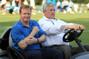 Roger Goodell (L), the Commissioner of the National Football League, rides along with Jerry Richardson (R), owner of the Carolina Panthers during training camp at Wofford College on August 3, 2011 in Spartanburg, South Carolina.