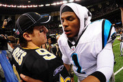 Drew Brees #9 of the New Orleans Saints is greeted by Cam Newton #1 of the Carolina Panthers after the game at the Mercedes-Benz Superdome on January 1, 2012 in New Orleans, Louisiana
