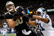 Jimmy Graham #80 of the New Orleans Saints has a pass broken up by  Mike Mitchell #21 of the Carolina Panthers at Mercedes-Benz Superdome on December 8, 2013 in New Orleans, Louisiana.