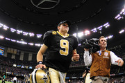 Drew Brees #9 of the New Orleans Saints heads off the field after the game against the Carolina Panthers at the Mercedes-Benz Superdome on January 1, 2012 in New Orleans, Louisiana