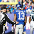 Odell Beckham Photos - Odell Beckham #13 of the New York Giants talks with a referee after a play with Josh Norman #24 of the Carolina Panthers during their game at MetLife Stadium on December 20, 2015 in East Rutherford, New Jersey. - Carolina Panthers v New York Giants