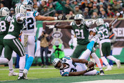 Cornerback Morris Claiborne #21 of the New York Jets reacts after a tackle on tight end Ed Dickson #84 of the Carolina Panthers during the second half of the game at MetLife Stadium on November 26, 2017 in East Rutherford, New Jersey.