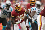 Running back Adrian Peterson #26 of the Washington Redskins rushes against the Carolina Panthers at FedExField on October 14, 2018 in Landover, Maryland.