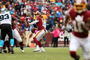 Alex Smith #11 of the Washington Redskins looks to pass during the second half against the Carolina Panthers at FedExField on October 14, 2018 in Landover, Maryland.