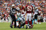 Cornerback Josh Norman #24 of the Washington Redskins exchanges words with quarterback Cam Newton #1 of the Carolina Panthers after a play in the fourth quarter at FedExField on October 14, 2018 in Landover, Maryland.