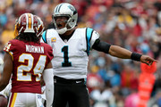 Cam Newton #1 of the Carolina Panthers reacts to Josh Norman #24 of the Washington Redskins after a play in the third quarter at FedExField on October 14, 2018 in Landover, Maryland.