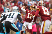 Quarterback Alex Smith #11 of the Washington Redskins throws a pass against the Carolina Panthers during the second half at FedExField on October 14, 2018 in Landover, Maryland.