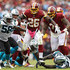 Adrian Peterson Photos - Running back Adrian Peterson #26 of the Washington Redskins rushes against the Carolina Panthers during the second half at FedExField on October 14, 2018 in Landover, Maryland. - Carolina Panthers vs. Washington Redskins