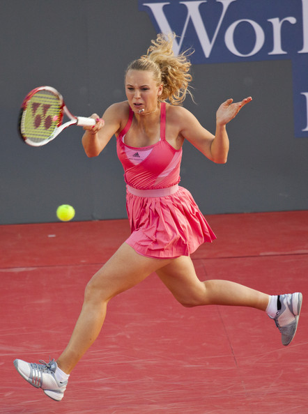 Caroline Wozniacki of Denmark plays a shot against Kim Clijsters of Belgium during their exhibition match at Centenial Park on January 1, 2011 in Hua Hin, Thailand.