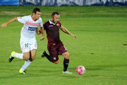 (R-L) Andrea Lucci of AS Livorno competes for the ball with Andrea Lazzari of Carpi FC during the TIM Cup match between Carpi FC and AS Livorno at Stadio Sandro Cabassi on August 16, 2015 in Carpi, Italy.