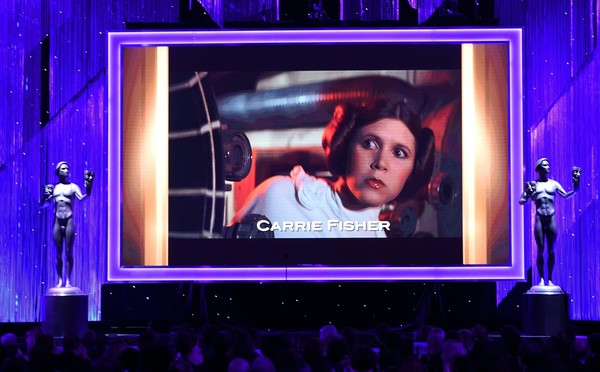 23rd Annual Screen Actors Guild Awards - Show [display device,led display,flat panel display,projection screen,stage,technology,performance,electronic device,magenta,screen,carrie fisher,robyn beck,screen actors guild awards,screen,memoriam,california,los angeles,the shrine auditorium,afp,show]
