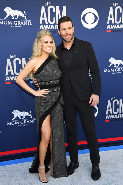 54th Academy Of Country Music Awards - Arrivals [event,premiere,carpet,dress,little black dress,electric blue,flooring,red carpet,arrivals,carrie underwood,mike fisher,l-r,las vegas,nevada,mgm grand hotel casino,academy of country music awards]