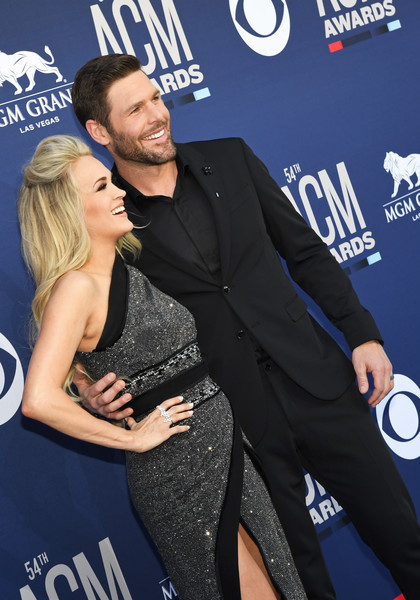 54th Academy Of Country Music Awards - Arrivals [premiere,event,suit,little black dress,carpet,formal wear,style,arrivals,carrie underwood,mike fisher,l-r,las vegas,nevada,mgm grand hotel casino,academy of country music awards]