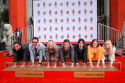 """(L-R) Johnny Galecki, Jim Parsons, Kaley Cuoco, Simon Helberg, Kunal Nayyar, Mayim Bialik and Melissa Rauch from the cast of """"The Big Bang Theory"""" attend their handprint ceremony at the TCL Chinese Theatre IMAX on May 01, 2019 in Hollywood, California."""